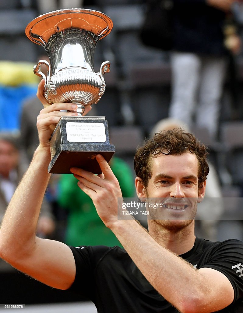 Britain's Andy Murray poses with his trophy after winning the men's final match against Novak Djokovic of Serbia at the ATP Tennis Open on May 15, 2016 at the Foro Italico in Rome. / AFP / TIZIANA