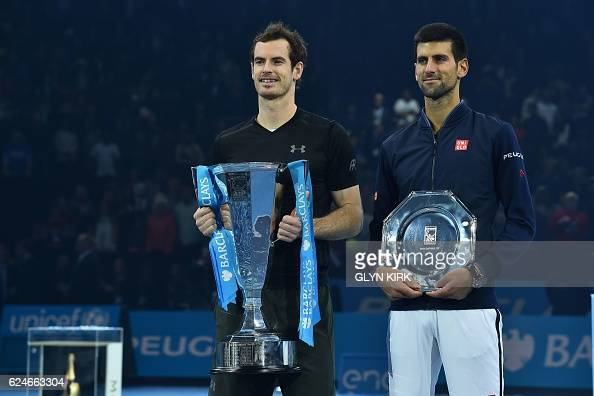 TOPSHOT Britain's Andy Murray poses with the ATP World Tour Finals trophy with runner up Serbia's Novak Djokovic after Murray won the men's singles...