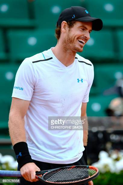 Britain's Andy Murray reacts after a point against Russia's Karen Khachanov during their tennis match at the Roland Garros 2017 French Open on June 5...