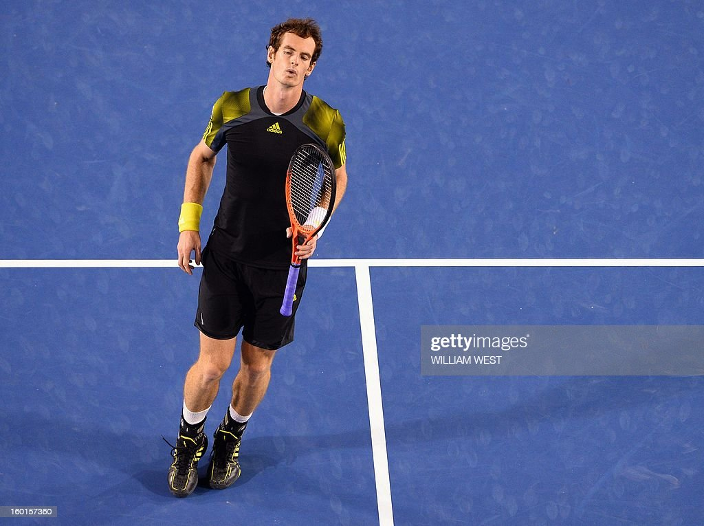 Britain's Andy Murray reacts after a point against Serbia's Novak Djokovic during the men's singles final on day 14 of the Australian Open tennis tournament in Melbourne on January 27, 2013. AFP PHOTO / WILLIAM WEST IMAGE STRICTLY RESTRICTED TO EDITORIAL USE - STRICTLY NO COMMERCIAL USE