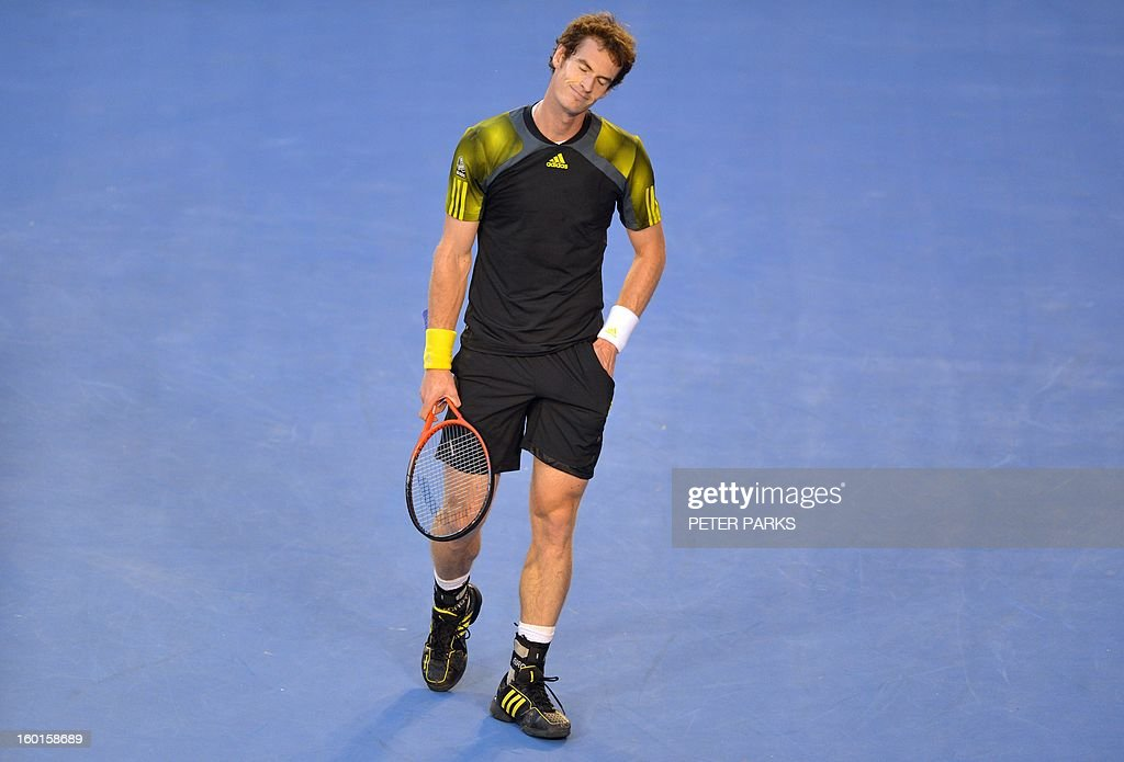 Britain's Andy Murray reacts after a point against Serbia's Novak Djokovic during the men's singles final on day 14 of the Australian Open tennis tournament in Melbourne on January 27, 2013. AFP PHOTO / PETER PARKS IMAGE STRICTLY RESTRICTED TO EDITORIAL USE - STRICTLY NO COMMERCIAL USE