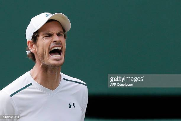 Britain's Andy Murray reacts after a point against US player Sam Querrey during their men's singles quarterfinal match on the ninth day of the 2017...