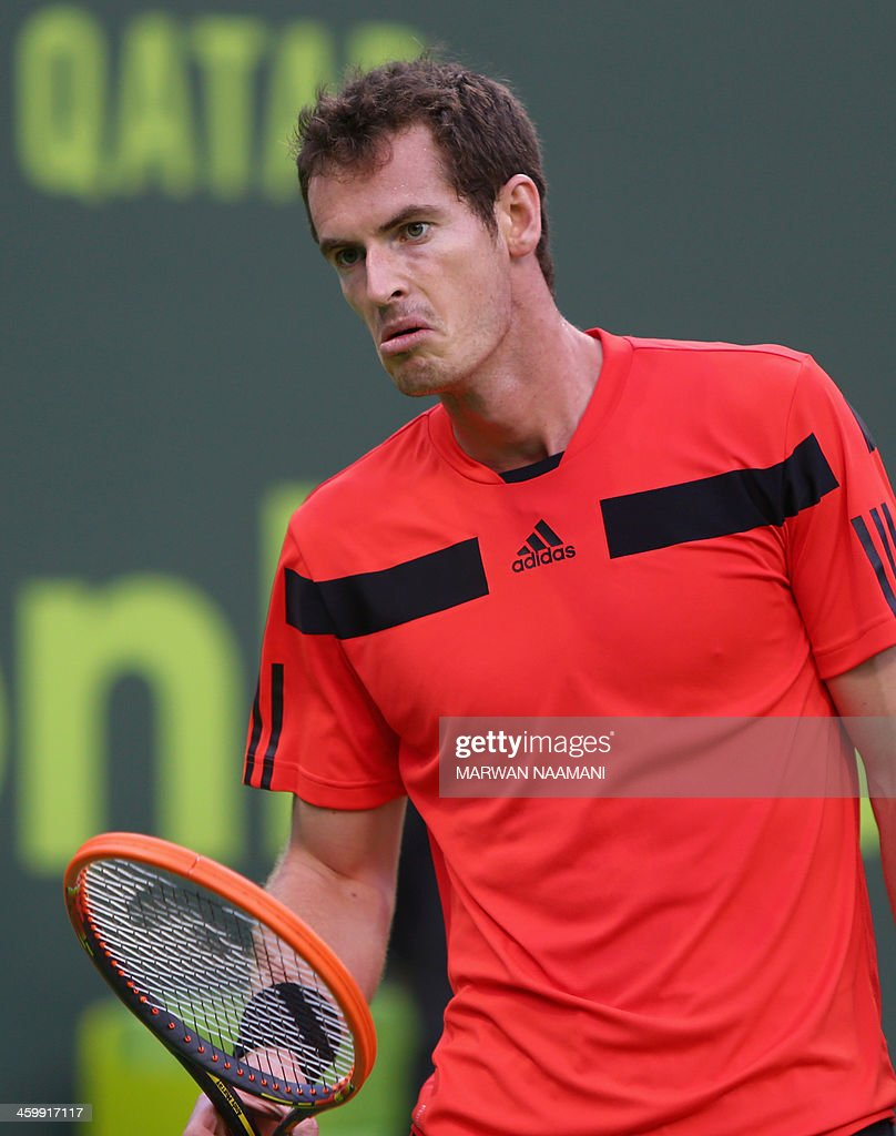 Britain's Andy Murray reacts after losing a point against Germany's Florian Mayer during their tennis match in Qatar's ExxonMobil Open in Doha on...