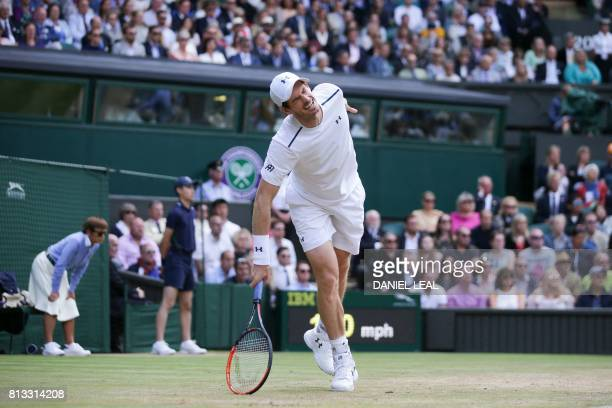 Britain's Andy Murray reacts after losing a point against US player Sam Querrey in their men's singles quarterfinal match on the ninth day of the...