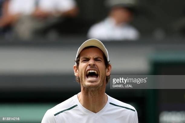 TOPSHOT Britain's Andy Murray reacts after losing a point against US player Sam Querrey in their men's singles quarterfinal match on the ninth day of...