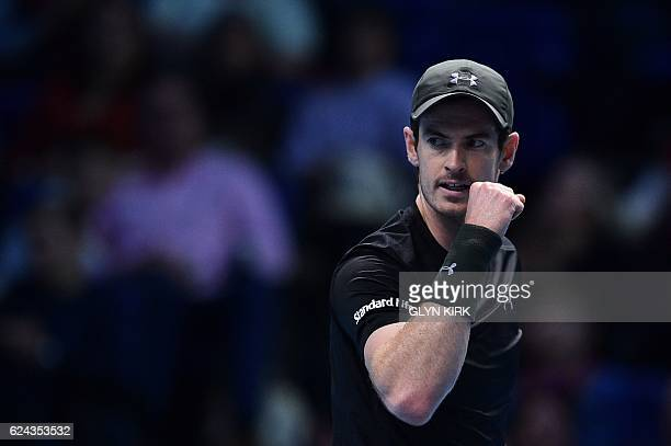 Britain's Andy Murray reacts after winning a point against Canada's Milos Raonic in the second set during their men's semifinal singles match on day...