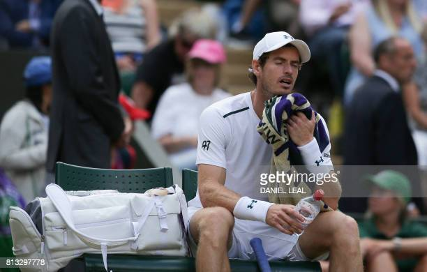 Britain's Andy Murray reacts as he sits in the break between games against US player Sam Querrey in their men's singles quarterfinal match on the...