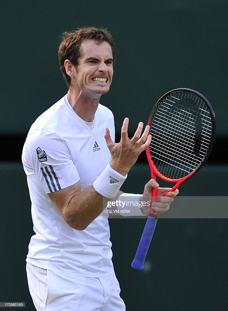 Britain's Andy Murray reacts during his men's singles quarter-final match against Spain's Fernando Verdasco on day nine of the 2013 Wimbledon Championships tennis tournament at the All England Club in Wimbledon, southwest London, on July 3, 2013. Murray won 4-6, 3-6, 6-1, 6-4, 7-5.