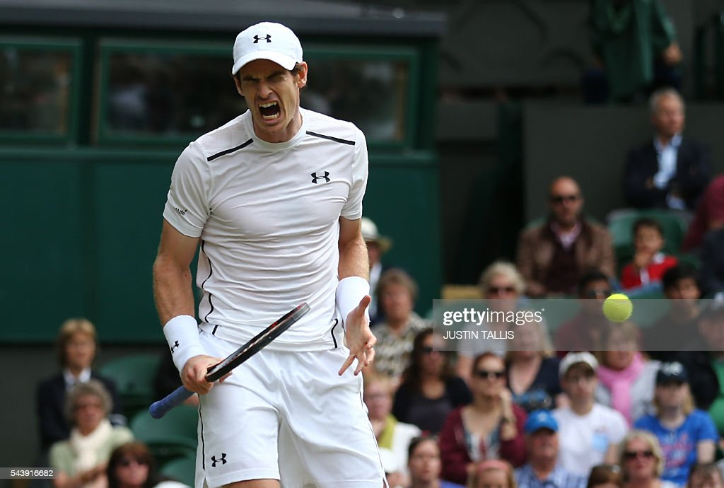 TOPSHOT - Britain's Andy Murray reacts while playing Taiwan's Lu Yen-hsun during their men's singles second round match on the fourth day of the 2016 Wimbledon Championships at The All England Lawn Tennis Club in Wimbledon, southwest London, on June 30, 2016. / AFP / JUSTIN
