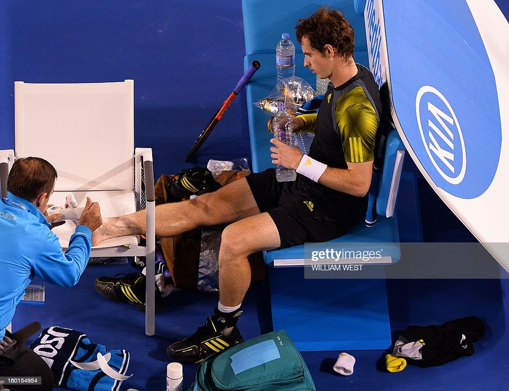Britain's Andy Murray receives treatment during a break in the men's singles final against Serbia's Novak Djokovic on day 14 of the Australian Open tennis tournament in Melbourne on January 27, 2013.