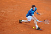 Britain's Andy Murray returns a backhand to Italy's Andreas Seppi during their Davis Cup quarterfinal tennis match Italy vs Great Britain in Naples...
