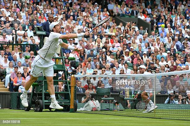 Britain's Andy Murray returns against Britain's Liam Broady at the net during their men's singles first round match on the second day of the 2016...