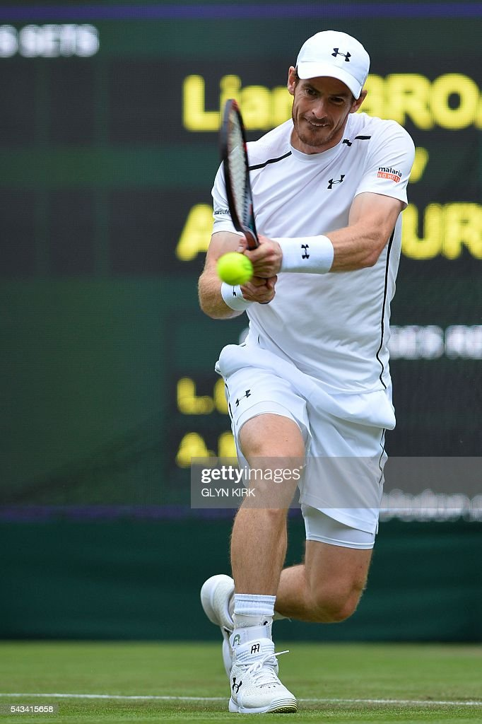 Britain's Andy Murray returns against Britain's Liam Broady during their men's singles first round match on the second day of the 2016 Wimbledon Championships at The All England Lawn Tennis Club in Wimbledon, southwest London, on June 28, 2016. / AFP / GLYN