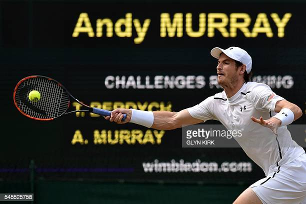 Britain's Andy Murray returns against Czech Republic's Tomas Berdych during their men's singles semifinal match on the twelfth day of the 2016...