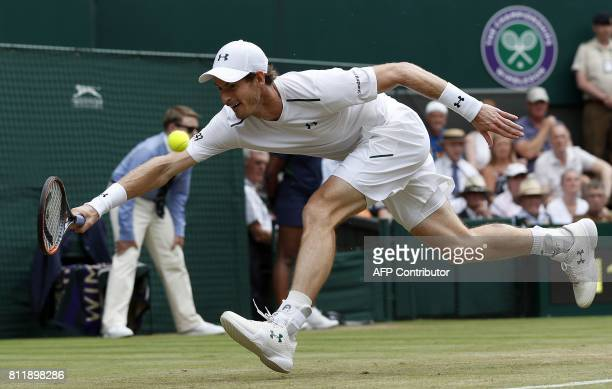 TOPSHOT Britain's Andy Murray returns against France's Benoit Paire during their men's singles fourth round match on the seventh day of the 2017...