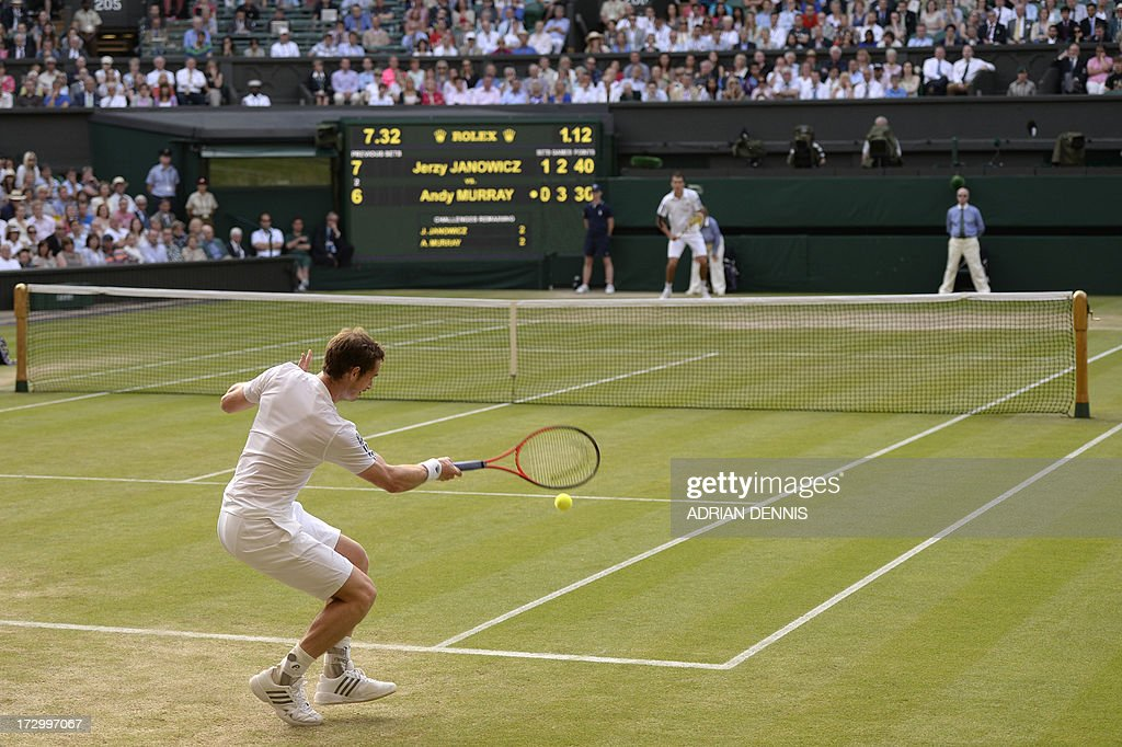 Britain's Andy Murray (bottom) returns against Poland's Jerzy Janowicz (top) in their men's singles semi-final match on day eleven of the 2013 Wimbledon Championships tennis tournament at the All England Club in Wimbledon, southwest London, on July 5, 2013. AFP PHOTO / ADRIAN DENNIS - RESTRICTED TO EDITORIAL USE