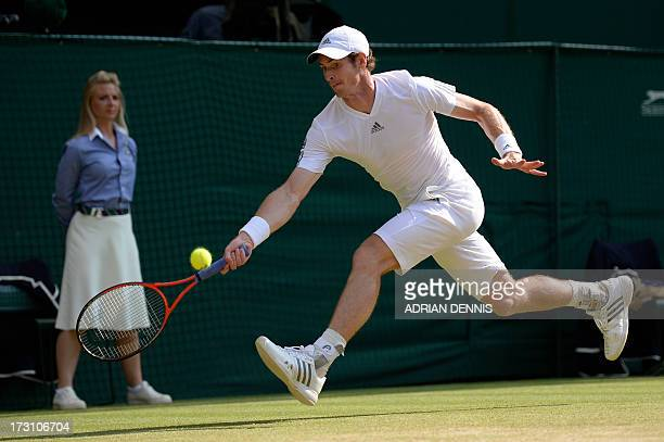 Britain's Andy Murray returns against Serbia's Novak Djokovic during the men's singles final on day thirteen of the 2013 Wimbledon Championships...