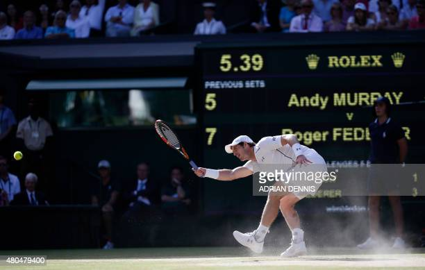 Britain's Andy Murray returns to Switzerland's Roger Federer during their men's semifinal match on day eleven of the 2015 Wimbledon Championships at...