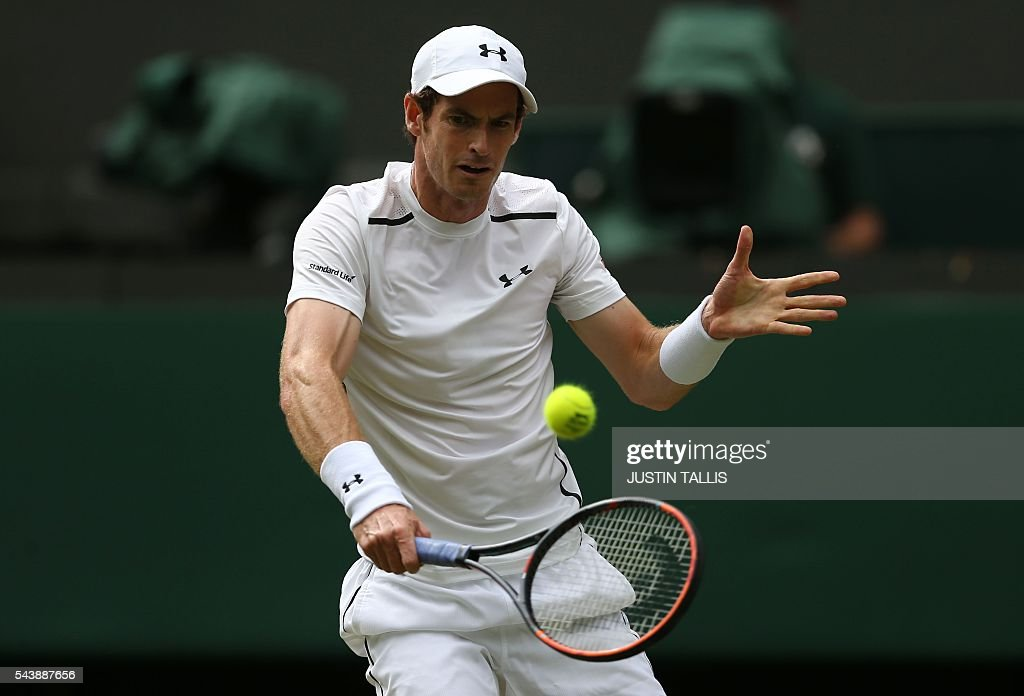 Britain's Andy Murray returns to Taiwan's Lu Yen-hsun during their men's singles second round match on the fourth day of the 2016 Wimbledon Championships at The All England Lawn Tennis Club in Wimbledon, southwest London, on June 30, 2016. / AFP / JUSTIN