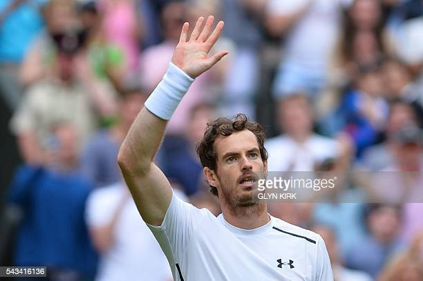 Britain's Andy Murray salutes the crowd after beating Britain's Liam Broady during their men's singles first round match on the second day of the...