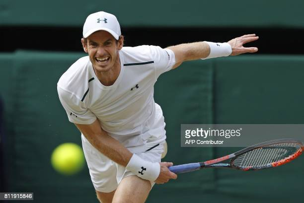 TOPSHOT Britain's Andy Murray serves against France's Benoit Paire during their men's singles fourth round match on the seventh day of the 2017...