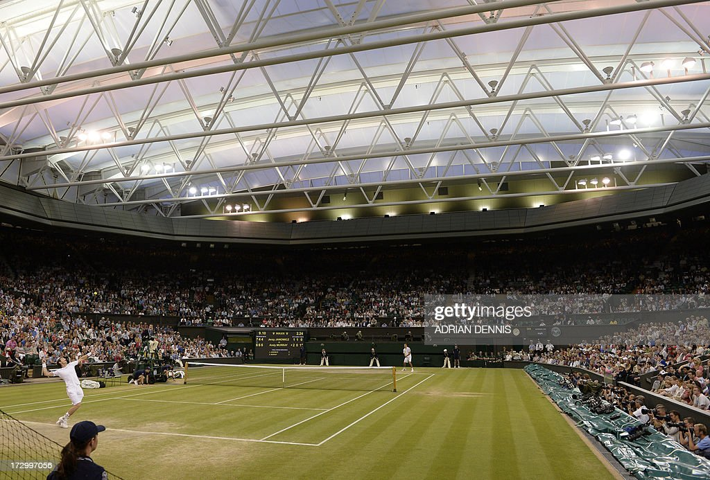 Britain's Andy Murray serves against Poland's Jerzy Janowicz in their men's singles semi-final match on day eleven of the 2013 Wimbledon Championships tennis tournament at the All England Club in Wimbledon, southwest London, on July 5, 2013.