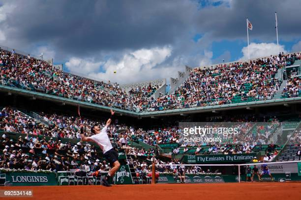 Britain's Andy Murray serves the ball to Russia's Karen Khachanov during their tennis match at the Roland Garros 2017 French Open on June 5 2017 in...