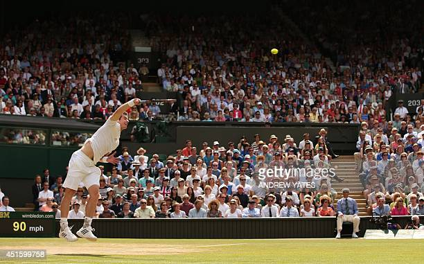 Britain's Andy Murray serves to Bulgaria's Grigor Dimitrov during their men's singles quarterfinal match on day nine of the 2014 Wimbledon...