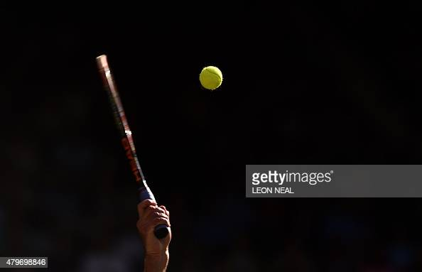 Britain's Andy Murray serves to Croatia's Ivo Karlovic during their men's singles fourth round match on day seven of the 2015 Wimbledon Championships...