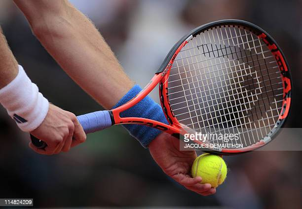 Britain's Andy Murray serves to Italia's Simone Bolelli during their men's second round match in the French Open tennis championship at the Roland...