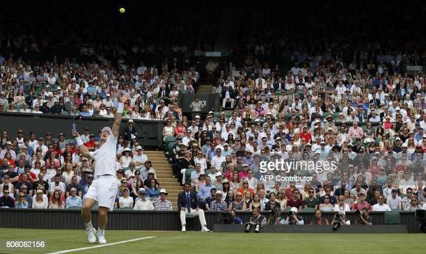 TOPSHOT Britain's Andy Murray serves to Kazakhstan's Alexander Bublik during their men's singles first round match on the first day of the 2017...