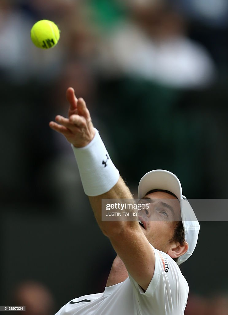 Britain's Andy Murray serves to Taiwan's Lu Yen-hsun during their men's singles second round match on the fourth day of the 2016 Wimbledon Championships at The All England Lawn Tennis Club in Wimbledon, southwest London, on June 30, 2016. / AFP / JUSTIN