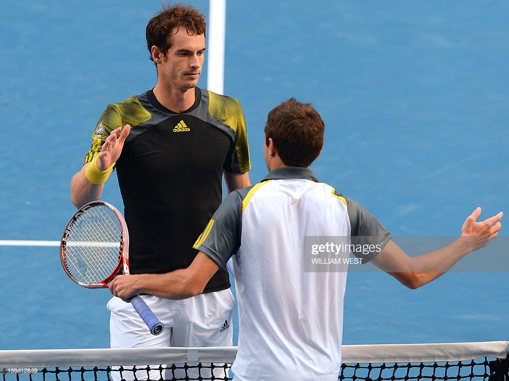 Britain's Andy Murray (L) shakes hands after victory in his men's singles match against France's Gilles Simon on the eighth day of the Australian Open tennis tournament in Melbourne on January 21, 2013.