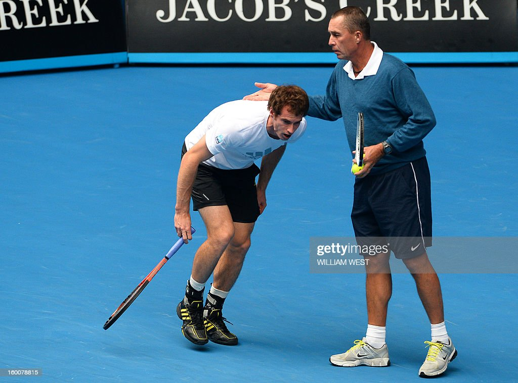 Britain's Andy Murray (L) speaks with his coach Ivan Lendl as he takes part in a training session on day thirteen of the Australian Open tennis tournament in Melbourne on January 26, 2013, ahead of his men's singles final against Serbia's Novak Djokovic.