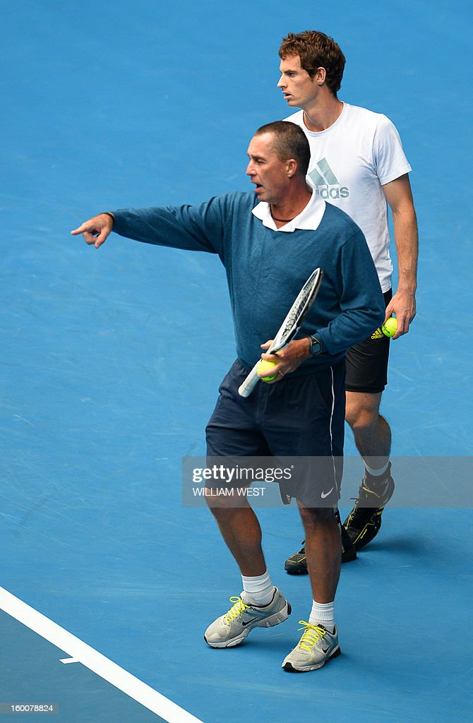 Britain's Andy Murray (R) speaks with his coach Ivan Lendl as he takes part in a training session on day thirteen of the Australian Open tennis tournament in Melbourne on January 26, 2013, ahead of his men's singles final against Serbia's Novak Djokovic.