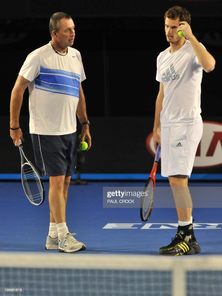 Britain's Andy Murray (R) speaks with his coach Ivan Lendl during a training session ahead of the Australian Open tennis tournament in Melbourne on January 13, 2013.