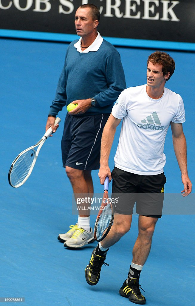 Britain's Andy Murray (R) stands next to his coach Ivan Lendl as he takes part in a training session on day thirteen of the Australian Open tennis tournament in Melbourne on January 26, 2013, ahead of his men's singles final against Serbia's Novak Djokovic.