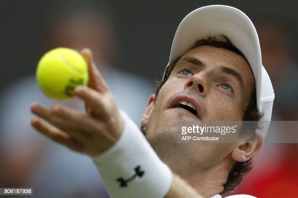 Britain's Andy Murray throws the ball to serve against Kazakhstan's Alexander Bublik during their men's singles first round match on the first day of...