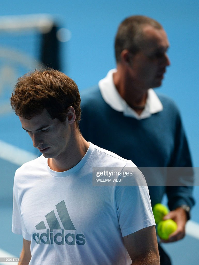 Britain's Andy Murray (L) walks on court with his coach Ivan Lendl as he takes part in a training session on day thirteen of the Australian Open tennis tournament in Melbourne on January 26, 2013, ahead of his men's singles final against Serbia's Novak Djokovic.