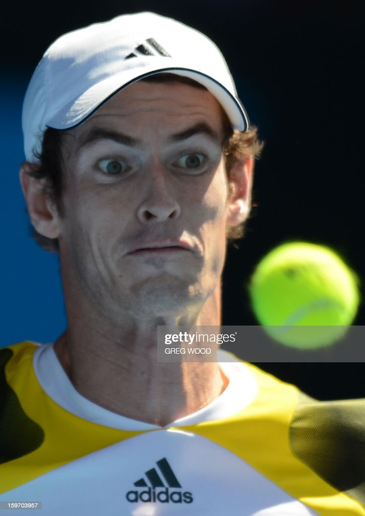Britain's Andy Murray watches the ball as he plays a return during his men's singles match against Ricardas Berankis of Lithuania on the sixth day of the Australian Open tennis tournament in Melbourne on January 19, 2013.
