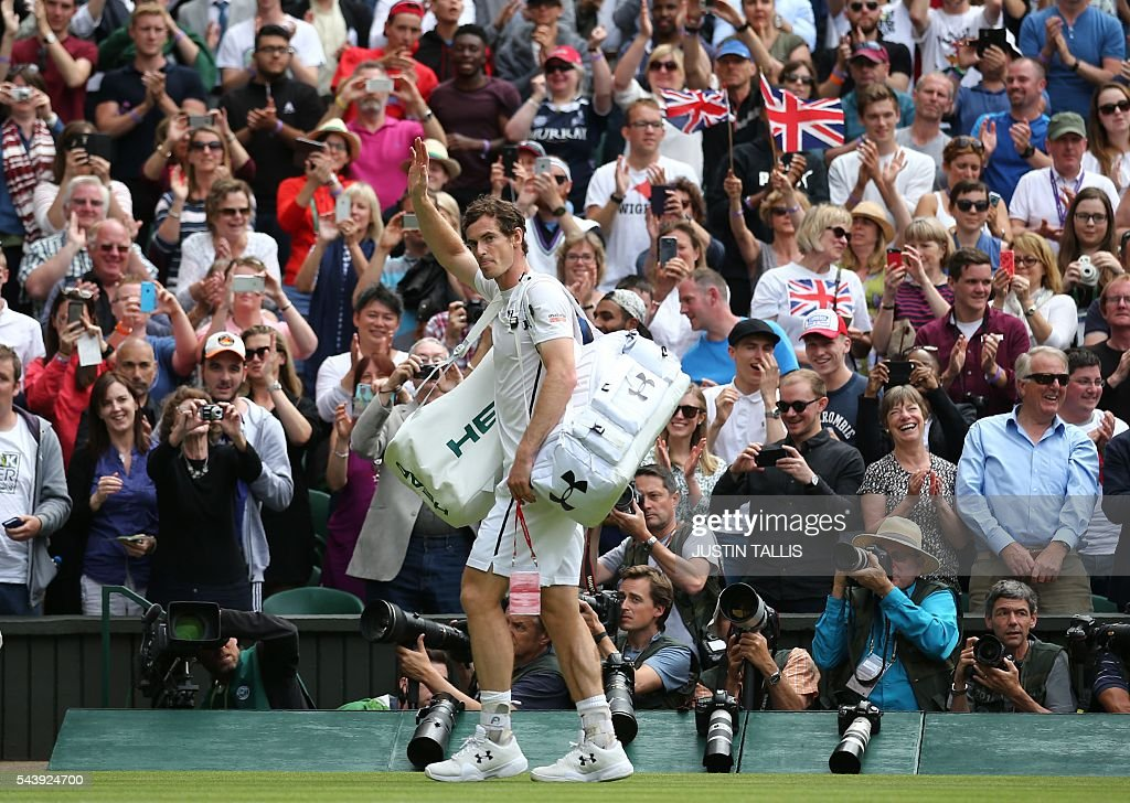 Britain's Andy Murray waves after beating Taiwan's Lu Yen-hsun during their men's singles second round match on the fourth day of the 2016 Wimbledon Championships at The All England Lawn Tennis Club in Wimbledon, southwest London, on June 30, 2016. / AFP / JUSTIN