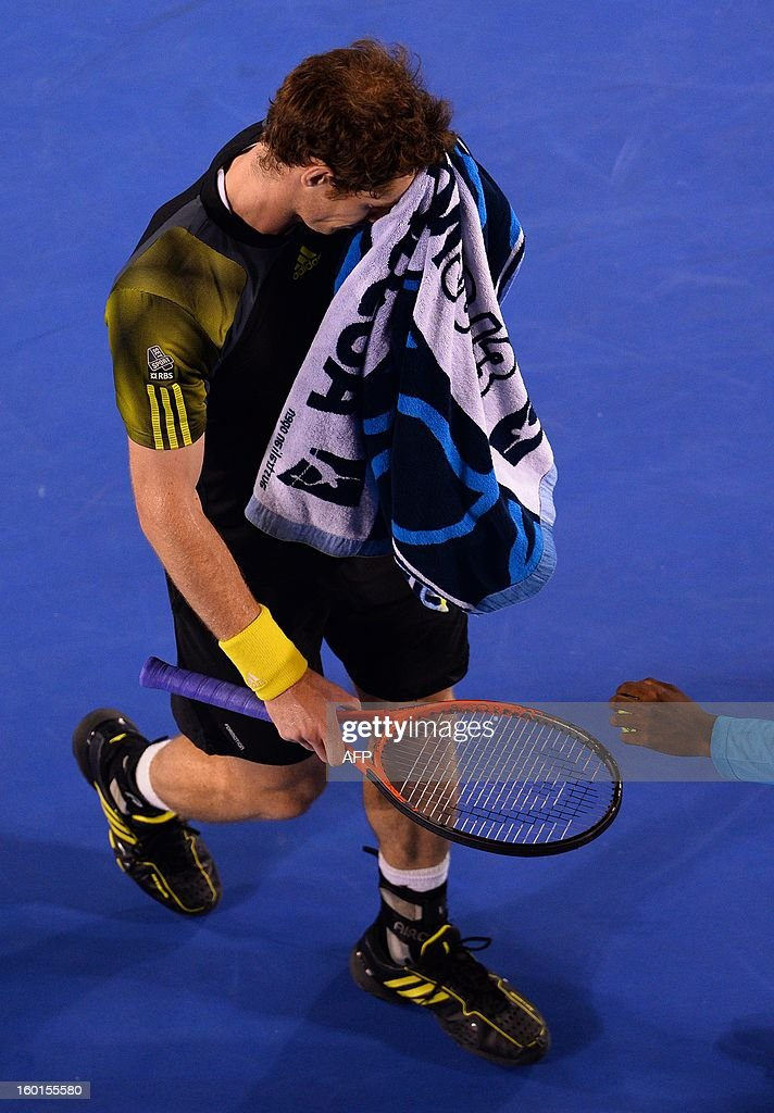 Britain's Andy Murray wipes himself with a towel during the men's singles final against Serbia's Novak Djokovic on day 14 of the Australian Open tennis tournament in Melbourne on January 27, 2013.