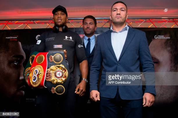 Britain's Anthony Joshua and Bulgaria's Kubrat Pulev and boxing promoter Eddie Hearn pose during a press conference at the Principality Stadium in...