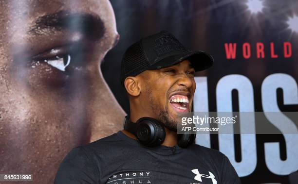 Britain's Anthony Joshua is seen during a press conference at the Principality Stadium in Cardiff on September 11 2017 during an event to promote his...