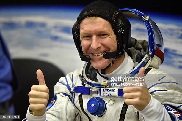 Britain's astronaut Tim Peake gestures as his space suit is tested at the Russianleased Baikonur cosmodrome prior to blasting off to the...