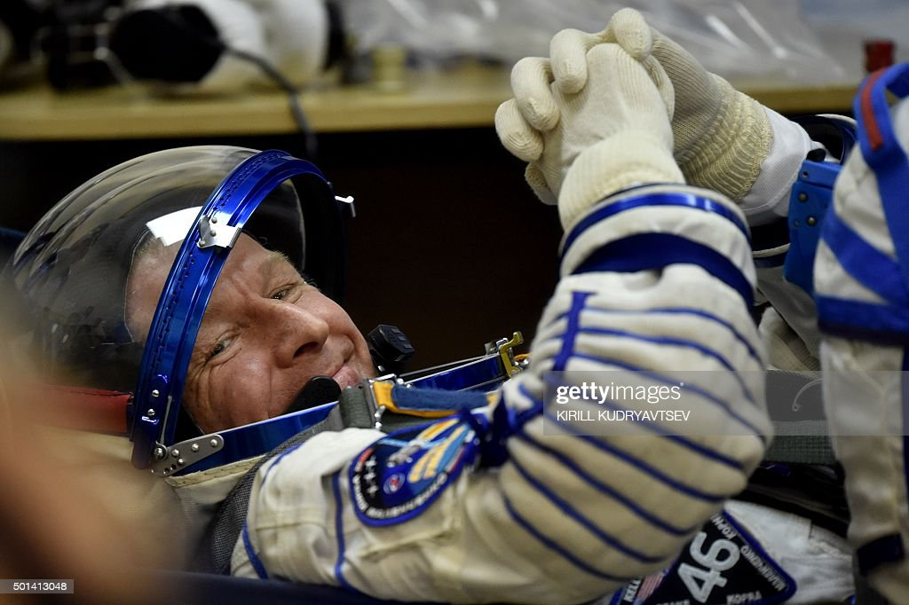 Britain's astronaut Tim Peake reacts as his space suit is tested at the Russian-leased Baikonur cosmodrome, prior to blasting off to the International Space Station (ISS), on December 15, 2015. Russia's Soyuz TMA-19M spacecraft carrying the International Space Station (ISS) Expedition 46/47 crew of Britain's astronaut Tim Peake, Russian cosmonaut Yuri Malenchenko and US astronaut Tim Kopra is scheduled to blast off to the ISS on December 15, 2015.