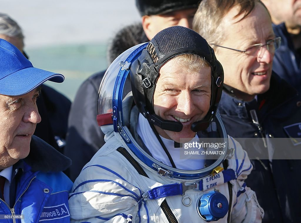 Britain's astronaut Tim Peake smiles as he walks to board the Soyuz TMA-19M spacecraft at the Russian-leased Baikonur cosmodrome, prior to blasting off to the International Space Station (ISS), on December 15, 2015. Russia's Soyuz TMA-19M spacecraft carrying the International Space Station (ISS) Expedition 46/47 crew of Britain's astronaut Tim Peake, Russian cosmonaut Yuri Malenchenko and US astronaut Tim Kopra is scheduled to blast off to the ISS on December 15, 2015.