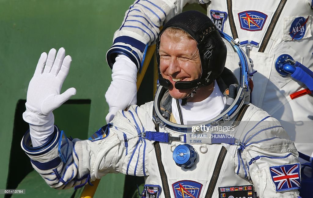 Britain's astronaut Tim Peake waves as he boards the Soyuz TMA-19M spacecraft at the Russian-leased Baikonur cosmodrome, prior to blasting off to the International Space Station (ISS), on December 15, 2015. Russia's Soyuz TMA-19M spacecraft carrying the International Space Station (ISS) Expedition 46/47 crew of Britain's astronaut Tim Peake, Russian cosmonaut Yuri Malenchenko and US astronaut Tim Kopra is scheduled to blast off to the ISS on December 15, 2015.