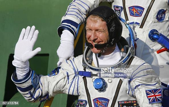 Britain's astronaut Tim Peake waves as he boards the Soyuz TMA19M spacecraft at the Russianleased Baikonur cosmodrome prior to blasting off to the...