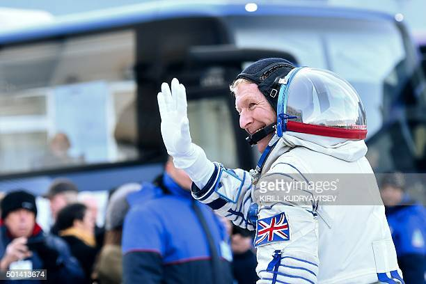 Britain's astronaut Tim Peake waves as he walks to board a bus at the Russianleased Baikonur cosmodrome prior to blasting off to the International...
